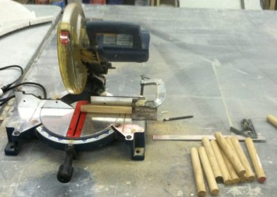 Wooden Dowels Being Cut
